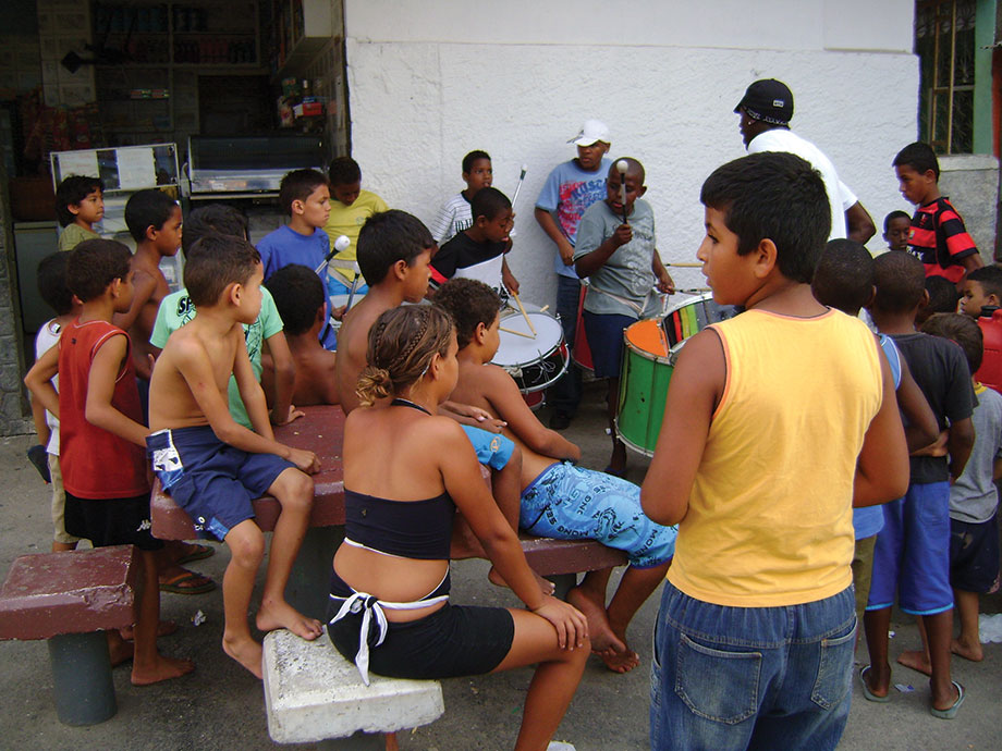 Figure 1 The imagination at work: Children enjoying playing drums in the favelas