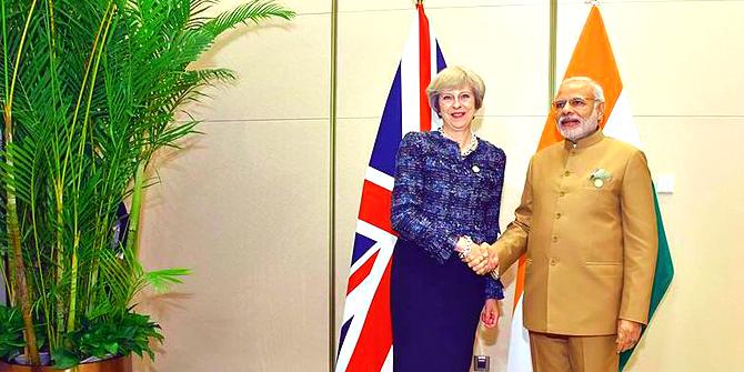 prime_minister_narendra_modi_meeting_british_pm_theresa_may_at_the_2016_g20_summit