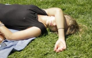 woman sleeping in park