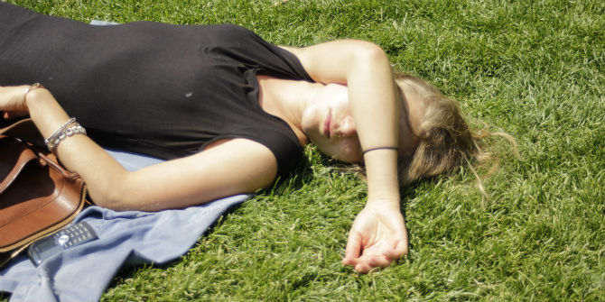 woman sleeping in park