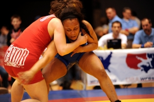 Sgt. Iris Smith (right) of the U.S. Army World Class Athlete Program battles Ali Bernard of the Gator Wrestling Club in the women's 72-kilogram/158.5-pound freestyle finale of the 2011 ASICS U.S. Open Wrestling Championships on April 9 at Public Hall in Cleveland. Bernard prevailed to win her third national championship. Smith, a four-time national champ, finished second. U.S. Army photo by Tim Hipps, FMWRC Public Affairs