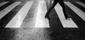 woman feet cross street