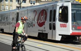 man-on-bike-and-bus
