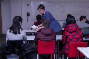 teacher hands students numbers