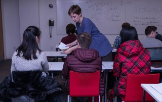 teacher hands students numbers, credit Catarina Heeckt