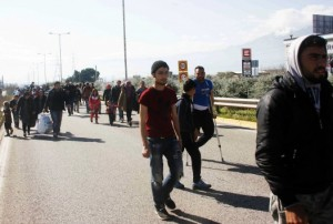 Refugees roaming Greece's central highways heading for the Greek borders
