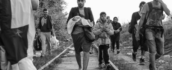 A man carries a 6-day-old child at Horgoš near the Hungary-Serbia border. © Elio Germani 2015 / Politico (published with the permission of the author)