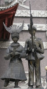 Visual representations of the Miao and music outside Kaili's stadium. Photo taken May 2011