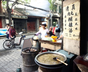 The breakfast stand frequented by local Muslim residents in the Hui communities. The sign on the right reads, 'Halal (Qingzhen in Chinese) meatball soup. Delicious ethnic cuisine'.