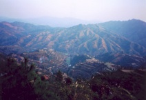Looking down into the main Sheeam valley, January 2005. Villagers must cross the mountain range seen here in order to reach the township centre and the closest local market (Photograph by Catherine Ingram)