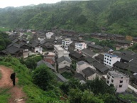 """Looking down into the centre of the largest village in Sheeam, Jai Lao, July 2008. The top of the main dare low (""""drum tower"""") can be seen left of centre (Photograph by Catherine Ingram)"""