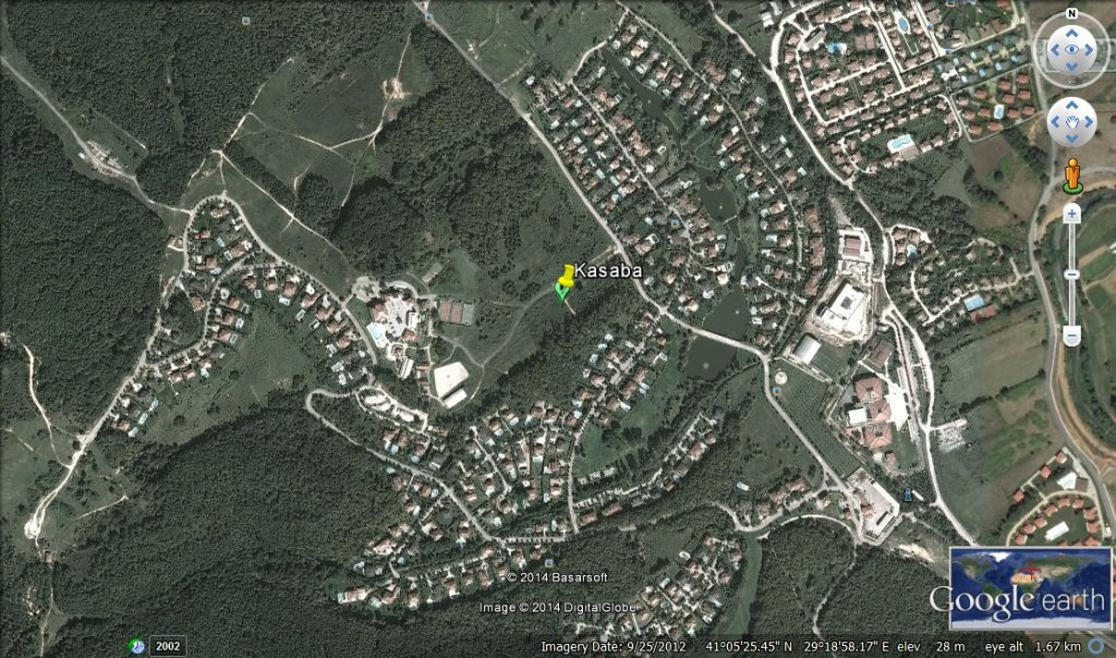 """The Google Earth image of Kasaba, located on the Anatolian side of the city in Omerli. It was built for high income residents, and promoted as a """"prestige"""" gated community of its developer company. It was designed to create a feeling of isolation and exclusivity for its residents, strengthened by dense forests surrounding it and its large detached villas, various amenities, including a private primary school and horse riding facilities inside the community. """"Kasaba"""" means """"town"""" in Turkish reflecting the size of its land and population, range of facilities, role in local community and municipality."""