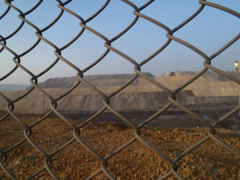 Figure 2: Tribal people are separated from their lands now under the mines by barbed wires (Photo credit: Kanchan Gandhi, February 2013)