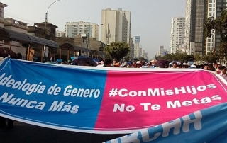 "Demonstration banner in blue and pink with words ""Con mis Hijos no te Metas"" (Spanish for ""Don't mess with our Children"")"