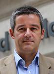 Portrait photo of Professor Charlie Beckett