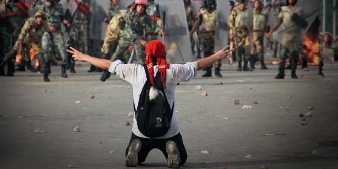 A protester faces Police