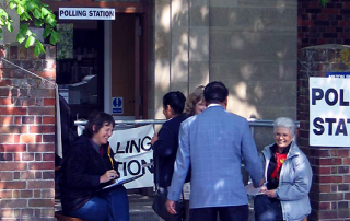 Voters arrive at a polling station