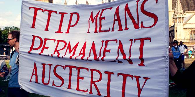 """Protestors hold a banner which says, """"TTIP means permanent austerity"""""""