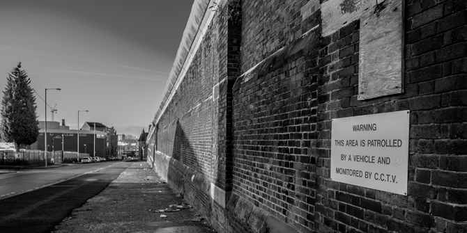A view of the wall of Strangeways prison in Manchester (credit - Lawrence Holmes)
