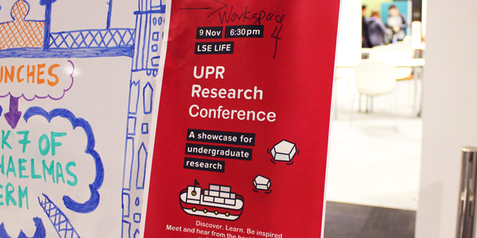 A poster for the conference pointing the way to the venue