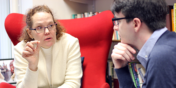 An academic talks to a student during office hours