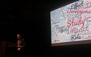 A speaker on stage at he BCUR 2018 closing ceremony