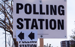 Picture of a local election polling station sign