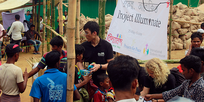 Jun Hao Peh handing out solar powered lights to Rohingya refugees during 'Project Illuminate'