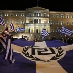 Supporters of Greece's far-right Golden Dawn party protest around a flag during a rally at central Syntagma square in Athens November 30, 2013. Hundreds of supporters gathered outside parliament on Saturday to protest the pre-trial detention of their leader Nikolaos Mihaloliakos, who faces charges of forming a criminal organisation. REUTERS/Yorgos Karahalis (GREECE - Tags: POLITICS CIVIL UNREST) - RTX15YYG