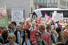 protesters with banners opposing TTIP