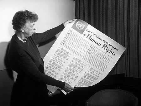 Eleanor Roosevelt inspects a copy of the Universal Declaration of Human Rights in 1949. (Creative Commons)