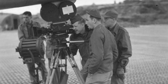 tv-film-crew-shooting-at-the-airport-vintage-image_w574_h725