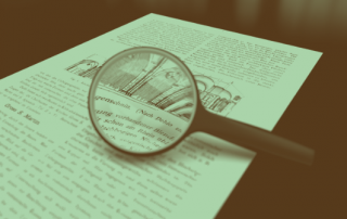 800px-Magnifying_glass_with_focus_on_paper