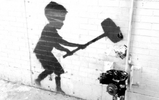 Banksy_Child_with_Hammer_NYC