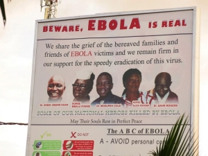 A billboard in Freetown. On the third day of my mission in Sierra Leone, Ebola took the life of Dr Godfrey George, adding to this list and further deepening the dent on the country's health system at this critical time. Photograph: Helen Mayelle/Save the Children/Sierra Leone