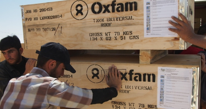 Oxfam team delivering T95 tanks to the warehouse in Zaatar from the Bicester warehouse
