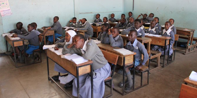 Kenyan students in class Photo Credit: Global Partnership for Education via Flickr (http://bit.ly/1N1mUNk)