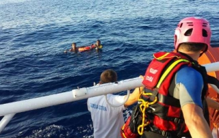 The Italian coastguard rescues two of the 156 survivors of the October 3 tragedy off Lampedusa Island.