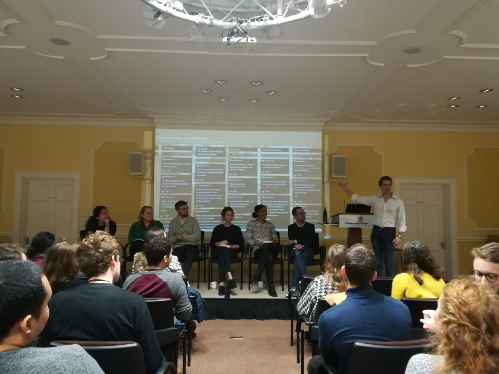 Fellows answer students' questions. From left to right: Dr Alexandra-Maria Bocse, Dr Cindy May, Dr Gustav Meibauer, Dr Zoe Williams, Dr Florence Dafe, Dr. Martin Hearson and Dr Tristen Naylor.