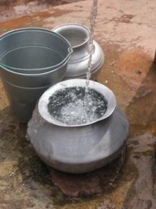 Water filled metal urns