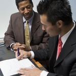 Investors signing