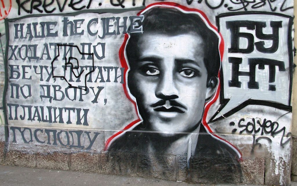 """Our shades shall roam Vienna, haunt the court, frighten the lords"", says this graffiti in Sarajevo, depicting Gavrilo Princip."