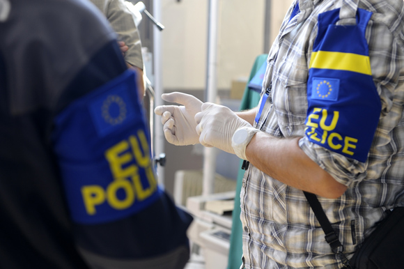 EULEX Police officers during a raid - image from www.eulex-kosovo.eu