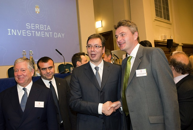 Serbian PM Aleksandar Vucic with Daniel Kawczynski MP and Crown Prince Aleksandar (far left) after his speech at the Serbia Investment Day at Central Hall Westminster, on October 29, 2014 (Photo by Peter Dench/Getty Images for Serbia Investment Day)