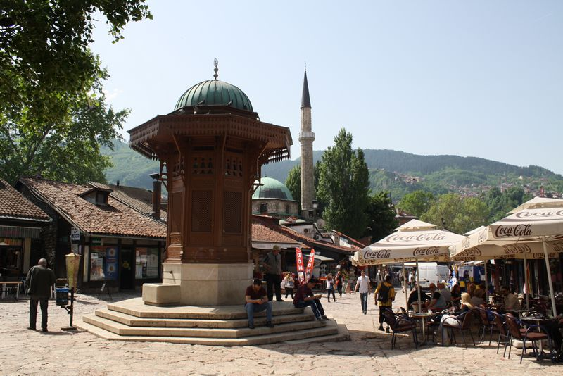 A restored wooden and stone fountain stands in Bašcaršija –the city's old bazar- since the foundation of the city in the 15th Century. 'They' say whoever drinks water from the fountain, will some day return to Sarajevo. Photo: Sofia Garcia 2014