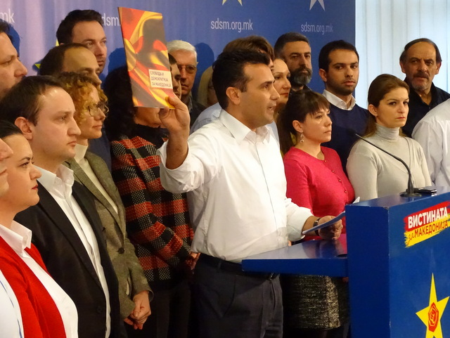 Opposition leader Zoran Zaev holding part of the transcripts at a press conferrence in Skopje | Photo by: Sinisa Jakov Marusic - BalkanInsight