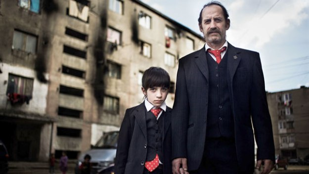A screenshot from Channel 4′s series 'The Romanians Are Coming', depicting Sandu and his son in the Romani ghetto in Baia Mare, Northern Romania.