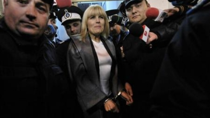 Former Tourism Minister Elena Udrea in handcuffs. Some critics of the anti-corruption drive have criticised the 'handcuff show' as reminiscent of a show trial.