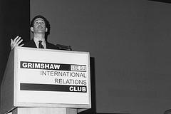 James Rubin speaking at a Grimshaw Club branded lectern
