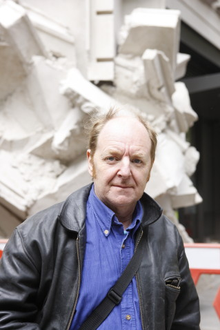 Richard Wilson RA in front of his 5-storey sculpture 'Square the Block' before it is mounted on the northwest exterior of the LSE New Academic Building on Kingsway. 14th September 2009